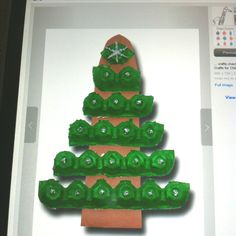 A Christmas tree using egg cartons!  Love it!  Great preschool Christmas craft!