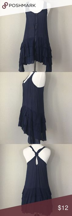 The Hanger full zipper front asymmetrical hem top The Hanger zippered top with ruffled asymmetrical hem. Longer on the sides than front and back. Size medium. New with partial tags. 60% Cotton 40% Rayon The Hanger Tops Tank Tops