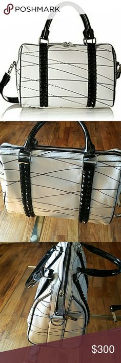 "L.A.M.B. Josie bag NWT L.a.m.b. leather studded satchel with detachable shoulder strap. 14.5 x 12.4 x 7.5. Shoulder drop 19"". Has some shelf wear. Reasonable offers welcome L.A.M.B. Bags"