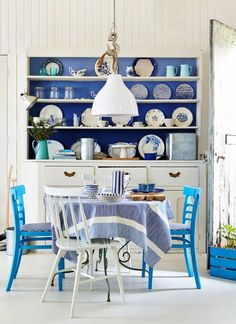 white and vibrant blues in the dining area Country Living Uk, Country Living Magazine, Okra, Beautiful Kitchens, Dining Area, Dining Rooms, Dining Table, Countertops, Kitchen Decor