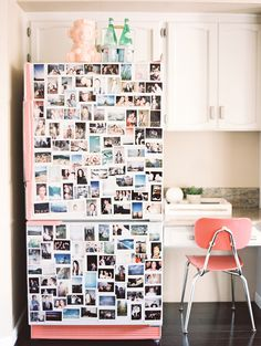 A cheeky and charming pink fridge covered in colorful snapshots.