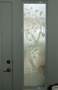 This frosted glass window is hand-crafted, sandblast frosted and 2D etched and shaded.  Available any size, all glass is custom made to order and shipped worldwide.