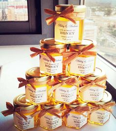 Stacked DIY Honey Wedding Favors create a pretty display at a wedding or bridal shower, where guests can choose their own delicious honey favor jars. The stacked display creates the look of a fancy favor display, on a budget.