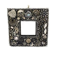 Decorative Wall Mirror - Jeweled Frame - Black and Silver - Repurposed Jewelry - Unique Wall Decor - Home Accent - Bling Mirror - For Her by Nostalgianmore on Etsy https://www.etsy.com/listing/115036028/decorative-wall-mirror-jeweled-frame
