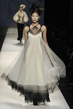 A version of this gown for the bride who wants a black and white wedding gown, With a different neckline treatment this would make a beautiful wedding dress. Jean Paul Gaultier SS 2009