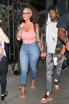 On the town: Amber Rose and 21 Savage were photographed emerging hand in hand from the celebrity-flypaper West Hollywood joint Catch LA on Wednesday