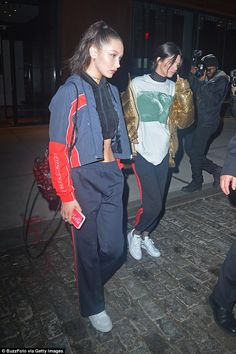 Casual night out:The supermodel pals were seen out on a very casual night as they ditched the glamour and covered up their famous figures in tracksuits