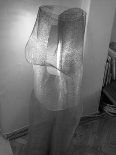 """""""La Vergine di Ferro"""" - iron grid and light, 2007."""