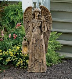 Resin Garden Angel With Solar-Lighted Lantern is peaceful and welcoming.