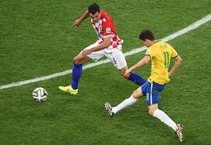 In the 90th minute, Brazil's Oscar wraps up victory when he races away and pokes an unexpectedly early shot into the near corner. Again, the keeper should have reached it ... that's game over
