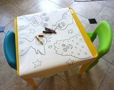 A coloring table is a good activity for little kids // Aidan's monster birthday party - tons of easy DIY decoration, kid-friendly activities, and adorable party favor ideas to save.
