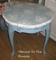 Remember the brown, wood tables that Grandma had?  Well, this is one of them...underneath anyway.  I used a mixture of my own duck egg blue chalk paint with white trim and a pretty damask stencil on the top.  Distressed to allow the gorgeous deep brown of the table to show through.  Waxed and stained to give it a nice time worn finish.  Gotta love that chalkpaint!