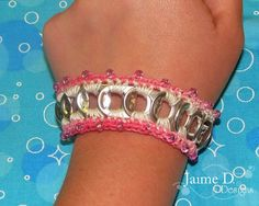 Crochet Pop Tab Bracelet   By: Jaime D. Designs      Materials:  Crochet thread, embroidery floss, DMC 5 or similar sized thread.  16 pop tabs for ...