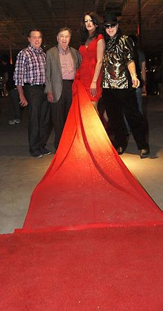 Larry Connelly, James Armstrong, and Your Style Avatar pose with Red Carpet at the fabulous Art Erotica.