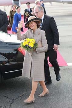 Queen Silvia of Sweden waves after her arrival to Tegel Airport in Berlin. The Swedish royal couple is on a four-day visit to Germany and stops include Berlin, Hamburg, Saxony-Anhalt, and Saxony