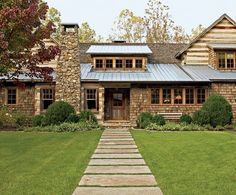 From Hooked on Houses blog. English Country Style House in the Smoky Mountains. One of the most 'sigh-worthy' houses, that I have everseen. Love the tin roof. Love the stonework. Love the timber. LOVE the cedar-shake...