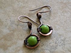 """Earrings. Copper. Wire Wrapped. Dangle. Rustic Finish. Metalwork. Beaded. Made To Order / """"Circle of Green"""" on Etsy, $26.00 Metalwork"""