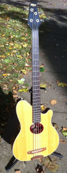 """The (snappily-named) """"Ibanez Talman Intertour TR-4B' - One of mine and I'm not sure how rare it is, but I've only ever seen one other for sale...it has an almost 'parlor guitar' feel to it. VERY bass-light,  given it's only about two inches thick, but it's super-sweet for late-night, EADG finger-picking. It's an exceptionally relaxing bass to play...and oddly, it also echoes Ton Dubbeldam's 'Early Spring', which should be around here somewhere...perspective...leaves...well,  you get the…"""