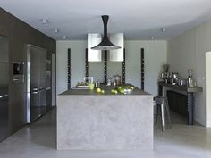 concrete kitchen - special crush on the wine totems on the back wall