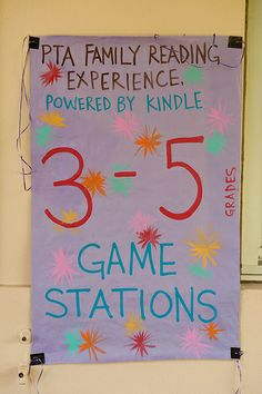 Longfellow PTA in Long Beach, CA displays colorful signs to help families navigate the Family Reading Experience stations
