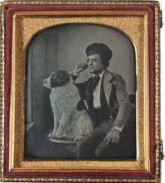 ca. 1850s, Daguerreotype portrait of a young man and his dog gazing out a window, their gazes fixed on the same point