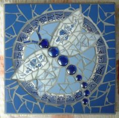 Mosaic Stepping Stones,on Craftster.org - GLASS CRAFTS