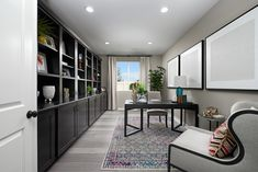 Beautiful built-in shelving Corporate Office Design, Modern Office Design, Office Interior Design, Office Interiors, Richmond Homes, Richmond American Homes, Commercial Office Design, Industrial Office Design, Solid Wood Desk