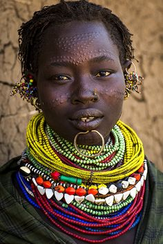 Topossa tribe woman in Kangate, EthiopiaTopossa woman in Kangate, Ethiopia. (Facial scarification, piercings, and layers of neck beads). African Tribes, African Women, We Are The World, People Around The World, Eric Lafforgue, Tribal People, African Culture, Photos Of Women, Interesting Faces