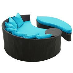 Wicker Patio Daybed With Ottoman And Blue Cushions