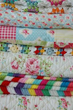 I love a pile of folded blankets and quilts!