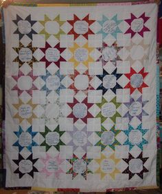 Cancer quilt - family members wrote messages in the middle of the stars. She can use the quilt during chemo so she remembers they're all with her in thought and prayer.