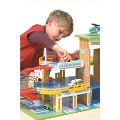 A little something for the adventurer. A three storey wooden garage from Le Toy Van with ramps and a working lift. The set includes a car and a helicopter