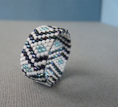 Winter Winds Woven Seed Bead Band Ring US Size 10.5 by SoukySuz on Etsy https://www.etsy.com/listing/116255733/winter-winds-woven-seed-bead-band-ring