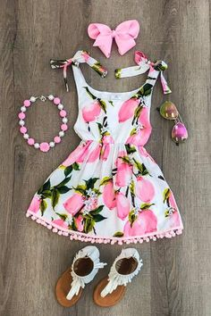 Our pink lemon dress is one of the cutest dresses we have seen and is super trendy! Pair with a long sleeve shirt, or cardigan, and leggings for fall to wear ye