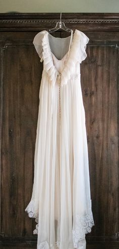Lovely photo. Beautiful dress. Amazing idea.....Custom wedding dress - made with mom's and grandmother's dress pieces.