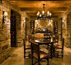 Reclaimed beams and ceiling boards, along with stone walls & limestone pavers make this wine cellar seem like it has seen centuries pass.