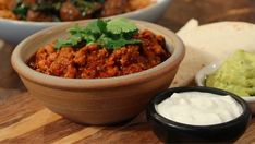 Why cook one dinner, when you can cook tonight's and tomorrow's at the same time using similar ingredients?  Phil Vickery's helping viewers make the most of their food shop by making two easy meal ideas from one main ingredient, as he cooks up beef chilli and spicy meatballs.