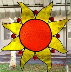 Sun fire stained glass sun catcher: You can almost feel the heat from this warm color work of art. Approx. 12 inches across, handcut pieces and red glass gems; sun catcher comes ready to hang. $45.00 #stainedglass #crafts #suncatchers
