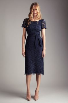Creepy model, gorgeous blue lace dress, Collette Dinnigan Spring 2012. (haha.. I agree with the previous statement.)
