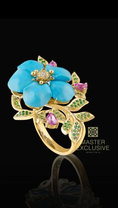 Ring 14K yellow gold, turquoise 13,4 ct, diamonds, blue diamonds, pink sapphires, tsavorite, demantoid.