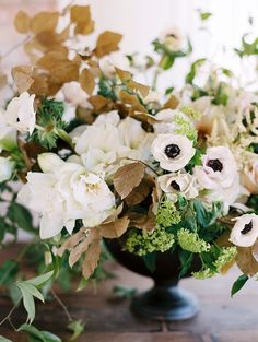 Green, White, and Neutral Centerpiece | Leo Patrone Photography | Fresh Green and Neutral Spring Wedding Ideas with a Hint of Gold and Wrapping Vines