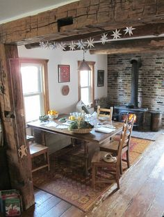 I read her beautiful blog, but her house is envy-worthy as well. Maybe one day I'll have a wood stove.