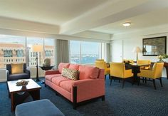 Make your getaway to Renaissance Boston Waterfront Hotel, a premier luxury destination located in Boston's vibrant Seaport District. Sofa, Couch, Hotel Deals, Travel Usa, Contemporary, Modern, Living Area, Renaissance
