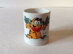 Garfield Holding Christmas Holly Ceramic Candle Holder 1978 Enesco Japan by afunspottoshop on Etsy