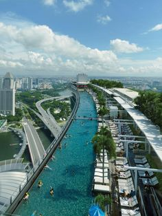 Ariel view of the Sands SkyPark atop the tripe tower Marina Bay Sands hotel in Singapore.