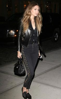 Gigi Hadid seems to have taken some inspiration from her rocker boyfriend Zayn Malik as she stepped out in a rocker chic ensemble comprising of black jeans with lace up and gold studded leather jacket. The 21 year old model, who made her first red carpet appearance with her boyfriend at the Met Gala, was running some errands in New York City on evening of May 5, 2016.