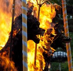 Hindu Funeral Ceremonies - The funeral pyres in the form of a lemu or bull are set on fire in one part of a Hindu cremation ceremony