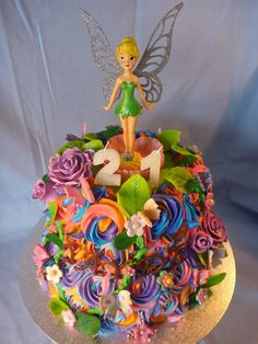 TINKERBELL CAKE  This multi-colour Tinkerbell cake was made for a special 21st Birthday. It was a two tier butter cake with rainbow buttercream rosettes. It also had handmade fondant roses, butterflies and flowers.  www.cakesbythelake.com.au