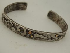 Funky artisan metalsmith cuff in sterling silver and a touch of 14k gold by JoDeneMoneuseJewelry