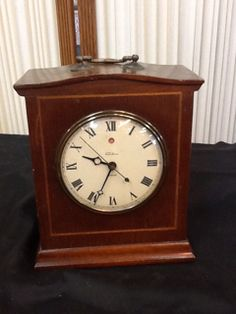 HANDSOME VINTAGE TELECHRON STRIKE ELECTRIC MANTEL CLOCK. THIS BEAUTY IS WALNUT WITH BRASS ACCENTS. MODEL NUMBER 6B15. HAS SOME MINOR SCRATCHES, ONLY ADDS CHARACTER. GOOD LUCK. 9H X 7W X 4D